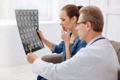 Competent medical expert explaining diagnosis stock photography