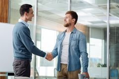Competent office worker meeting his colleague royalty free stock photos
