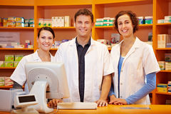 Competent pharmacy team. With pharmacist and pharmacy technicians Royalty Free Stock Image