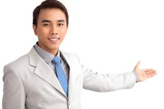 Competent representative. Isolated image of a young man presenting new product or service Royalty Free Stock Photos