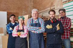 Competent and successful team of carpenters. With arms crossed Stock Photography