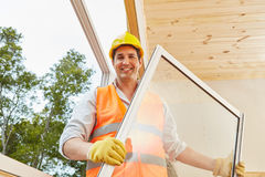 Competent window fitter working in woodhouse. Installation process Royalty Free Stock Image