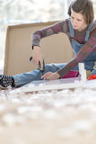 Competent woman assembling flat pack furniture Stock Photos