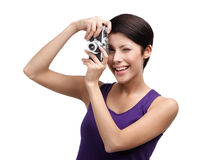 Competent woman hands retro photographic camera. Competent woman in spectacles hands retro photographic camera, isolated on white Stock Photo