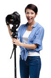 Competent woman-photographer takes pictures Stock Photos