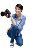 Competent woman-photographer takes shots Royalty Free Stock Photography