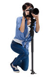 Competent woman-photographer takes snapshots. Woman takes images holding photographic camera, isolated on white background stock images