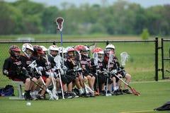 Competiam da lacrosse dos meninos da juventude Foto de Stock