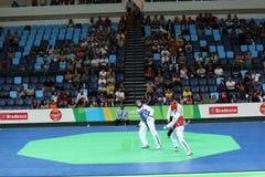 Competiam internacional de Taekwondo - Rio 2016 eventos do teste - UZB contra IRI Fotos de Stock