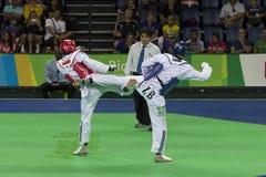 Competiam internacional de Taekwondo - Rio 2016 eventos do teste - UZB contra IRI Imagem de Stock Royalty Free