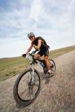 Competición de la bici de montaña de la aventura del resorte Imágenes de archivo libres de regalías