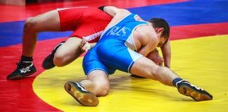Competiciones en la lucha grecorromana Foto de archivo libre de regalías