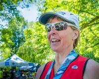 Competidor femenino en raza del Triathlon de Ironman Imagen de archivo libre de regalías
