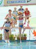 Competidores de las mujeres de la carrera de obstáculos de los 3000m fotos de archivo libres de regalías