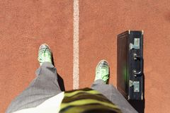 Competing business man on running track royalty free stock photography