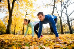Competing couple prepared for run Royalty Free Stock Images