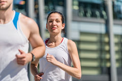 Competing - jogging in two Royalty Free Stock Images