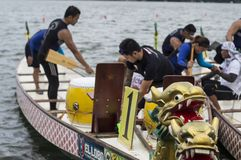 Competing teams of people embark on Sports Native Row Dragon head Boats during Dragon Cup Competition. San Pablo City, Laguna, Philippines - January 9, 2016 stock image