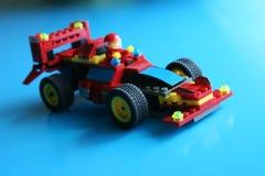 Competir con el coche del juguete Imagenes de archivo