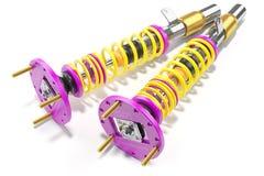 Competir con los amortiguadores de choque con las primaveras del yelllow Imagen de archivo