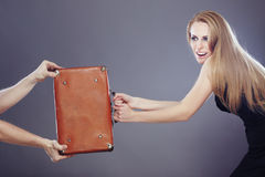 Competition. Businesswoman holding bag with money and competiting with hands of somebody Stock Images