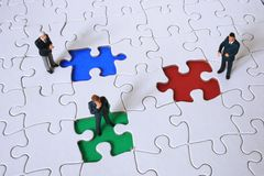 Competition. Business team with colored puzzle pieces Royalty Free Stock Photos