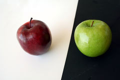 Competition. Two apples on white royalty free stock photography