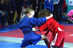 Competition.attack. An image of two schoolgirls on Sambo competitions Stock Photo