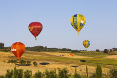 Competition of balloons in Italy. GUALDO CATTANEO, ITALY - JULY 31, 2016: Sagrantino International Challenge Cup. Colored balloons flies over a field Stock Photo