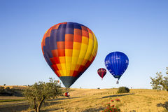 Competition of balloons in Italy. GUALDO CATTANEO, ITALY - JULY 31, 2016: Sagrantino International Challenge Cup. Colorful hot air balloons flying in the sky Stock Photo