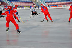 Competition for bandy. Russian Premier League match ball hockey:  Lokomotiv  Orenburg  Universal  Saratov Royalty Free Stock Photo