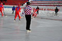 Competition for bandy. Russian Premier League match ball hockey:  Lokomotiv  Orenburg  Universal  Saratov Royalty Free Stock Photography