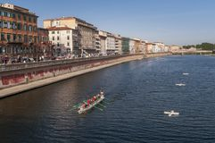 Competition boat on river Arno, Pisa, Tuscany, Italy Royalty Free Stock Image