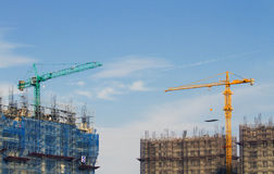 Competition of building by cranes Royalty Free Stock Photos