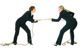 Competition In Business Field. Two businesswomen showing struggle face pulling rope with each another. concept for competition Stock Image