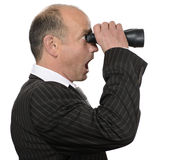 Competition. Businessman with binoculars watching something stunning Stock Photo