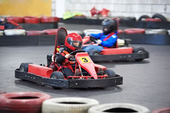 Competition for children karting. Indoors Stock Photography
