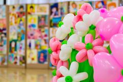Competition of children`s drawings. Exhibition of children`s art. Colorful balloons in the foreground. Defocused background.  Stock Photography