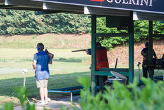 Competition of clay pigeon shooting. Shooters during a competition of clay pigeon shooting Royalty Free Stock Images