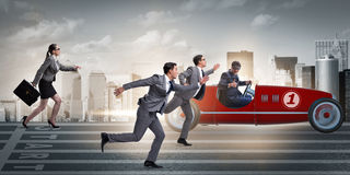 The competition concept with business people competing Royalty Free Stock Images