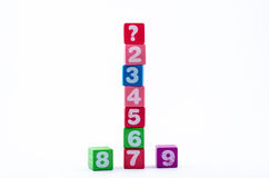 Competition. Concept by number on colorful wooden block and isolate from hite background Royalty Free Stock Photo
