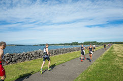 Competition. Contestants in the Vitruvian triathlon (comprising a 1900m swim, a 85 km bike ride and a 21 km run) at Rutland Water on Saturday 29 August 2015 stock photos