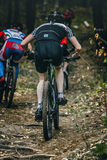 Competition cyclists uphill Royalty Free Stock Photos