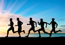 Competition of five runners athletes Royalty Free Stock Photo