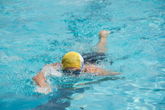 Competition front crawl race pool swimmer. An athlete trains in the pool finish lane swimming Stock Image