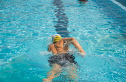 Competition front crawl race pool swimmer. An athlete trains in the pool finish lane swimming Stock Photo