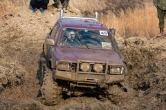 Competition in a jeep-trial among amateurs and professionals in driving along poor health on 4x4 cars stock photos