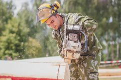 Competition of professional skill `Woodcutter` in the Kaluga region of Russia. July 11, 2019 in the Kaluga region held a competition of professional skills ` royalty free stock photo