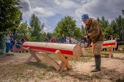 Competition of professional skill `Woodcutter` in the Kaluga region of Russia. July 11, 2019 in the Kaluga region held a competition of professional skills ` stock photography