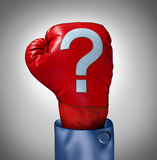 Competition Questions. As a business concept with a red boxing glove and a question mark stitched on the leather surface as a metaphor for strategy uncertainty Stock Image